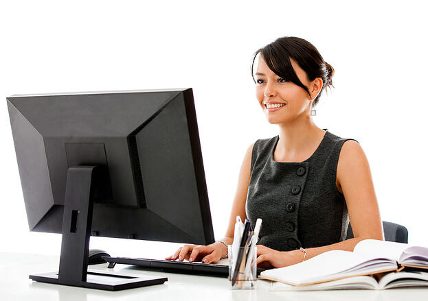 Business woman writing a franchise business plan to get financing
