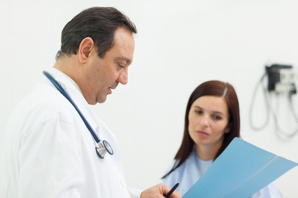 Doctor and a patient talking in an examination room.jpeg