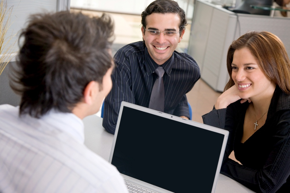 young couple working with a mortgage broker