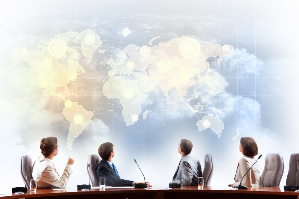 Image of businesspeople at presentation looking at virtual project.jpeg