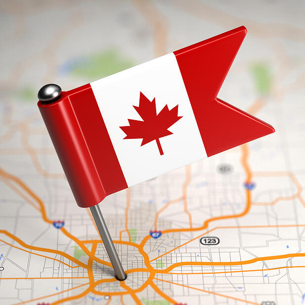 Small Flag of Canada on a Map Background with Selective Focus.-1