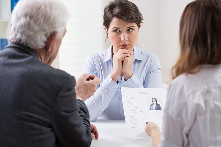 Woman during difficult job interview at a corporation.jpeg