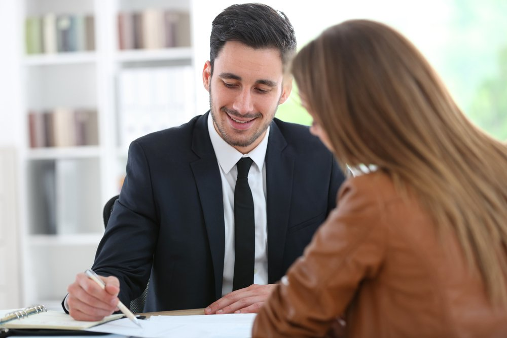 Franchise lawyer engaging with client in office