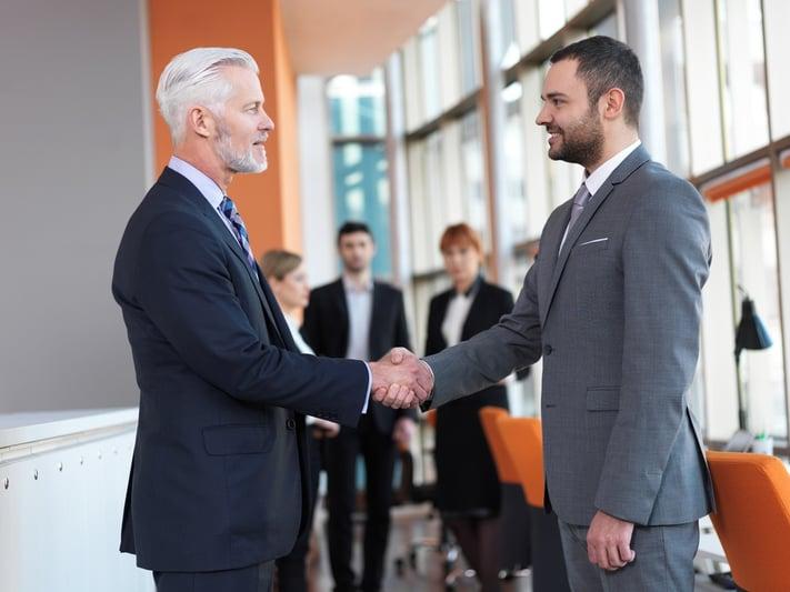 business partners, partnership concept with two businessman handshake.jpeg