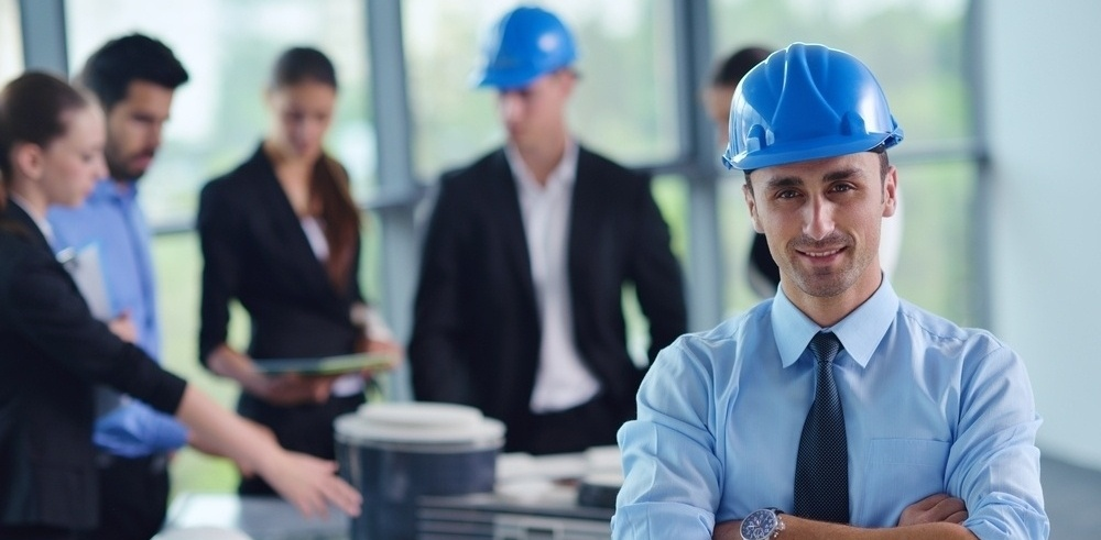 business people group on meeting and presentation  in bright modern office with construction engineer architect and worker looking building model and blueprint planbleprint plans-661472-edited-774670-edited