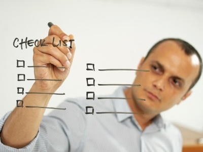 man-writing-checklist-whiteboard-400x300.jpg