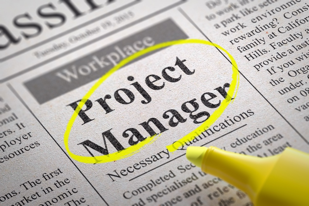 Project Manager Jobs in Newspaper. Job Search Concept..jpeg